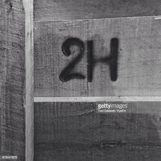 Number With Alphabet On Wooden Plank