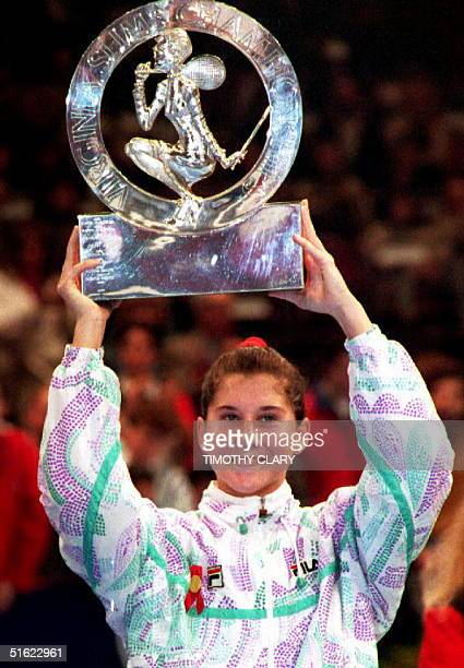 Numberone seed Monica Seles of the US holds her trophy after beating No 4 Martina Navratilova of the US to win the Virginia Slims Tennis...