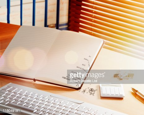 Numbers falling off the page. : Stock Photo
