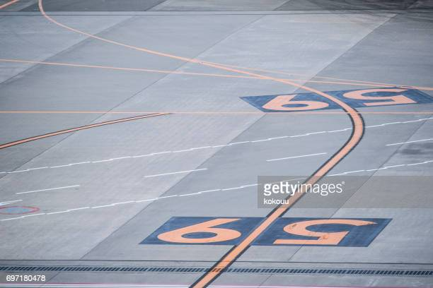 Numerals drawn on the runway at the airport.