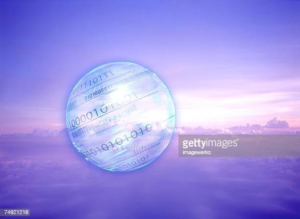 Numeric globe against cloudy sky