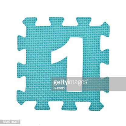 Numeric toy piece isolated on white background : Stock Photo