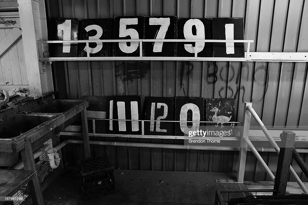 Numerical boards are stacked inside The Jack Fingleton Scoreboard during an international tour match between the Chairman's XI and Sri Lanka at Manuka Oval on December 8, 2012 in Canberra, Australia. The Jack Fingleton Scoreboard was first erected at the MCG in 1901. In 1982 it was replaced by an electronic board and donated to the Manuka Oval by the Melbourne Cricket Club as memorial to J.H.W Fingleton OBE.