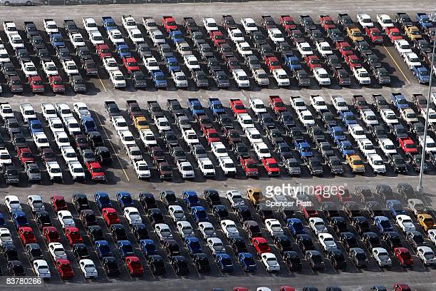 Numerous 2009 Ford F150 trucks are parked in a lot before being shipped on November 21 2008 in Detroit Michigan As car and truck sales have plummeted...