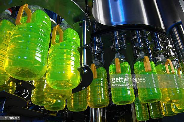 Numerous bottles with green liquid