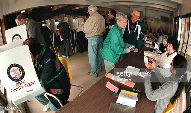 Numerous voters crowd into a small room as they cast their ballots for the presidential elections November 7 2000 in Des Plaines a Cook County suburb...