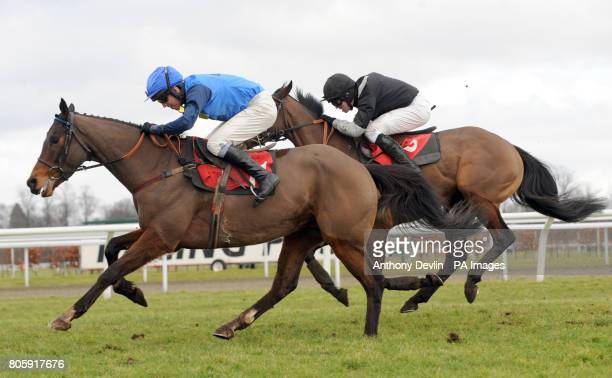 Numide ridden by Joshua Moore and Stripe Me Blue ridden by Leighton Aspell in action during the Racing Football Outlook Handicap Hurdle Race at...