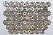 1999-2009 US State Quarters Territories complete set of 56 used coins with a unique image on the reverse of each.The picture includes 2 coins with the obverse common to all. Laid out in the order of t