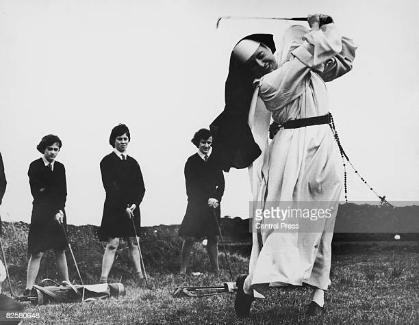 Nun and golf coach Sister Mary Martina takes an iron shot on the golf course at Rosebud Country Club Portsea Victoria Australia 6th September 1965...