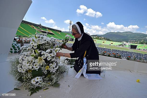 A nun arranges flowers on the stage at Sarajevo city stadium on June 5 a day ahead of the Pope's visit Pope Francis flies into Sarajevo on June 6...
