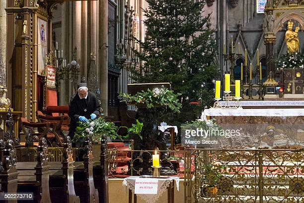 A nun arranges some Christmas decorations on the main altar inside the Catholic Cathedral on December 22 2015 in Zagreb Croatia Zagreb was voted last...