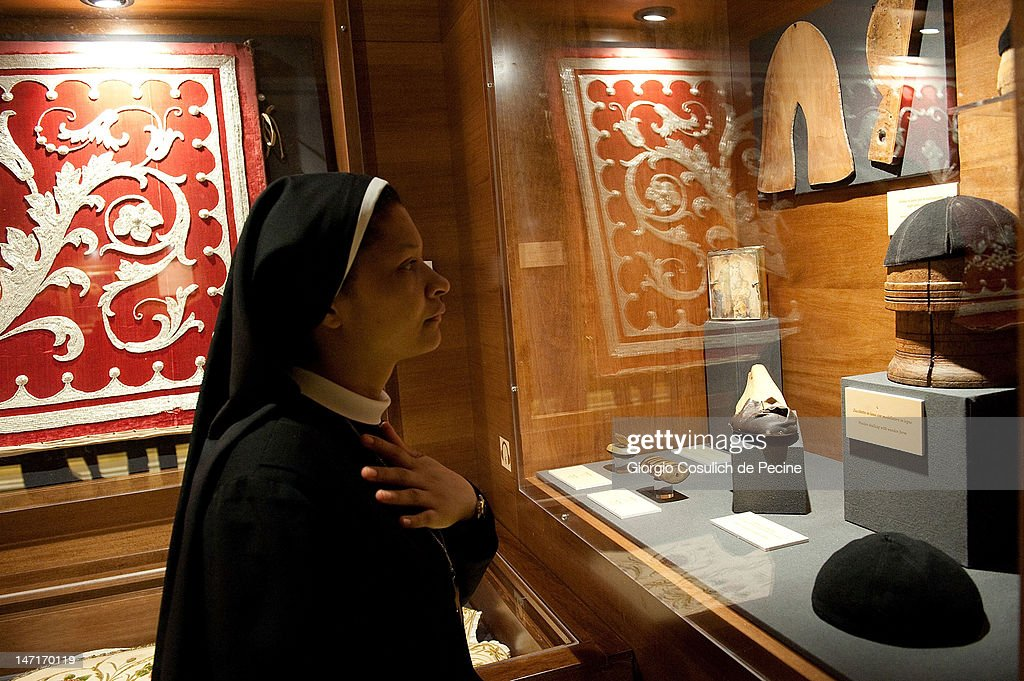 A nun attends the opening of the museum in the Capuchin convent of the Immaculate Conception of the Blessed Virgin Mary on June 26, 2012 in Rome, Italy. The monastery, which was first used by Capuchin monks and nuns in 1626, has become a destination for tourists from all over the world who visit an ossuary in the crypt which contains the skeletal remains of 3,700 monks.