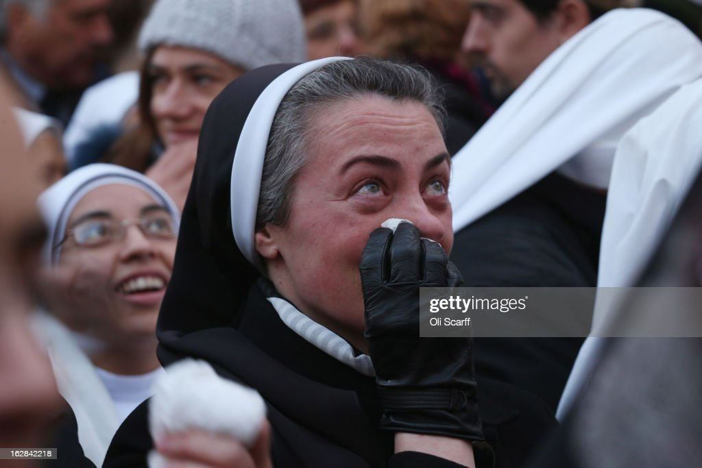A nun becomes emotional as Pope Benedict XVI waves to pilgrims, for the last time as head of the Catholic Church, from the window of Castel Gandolfo where he will start his retirement today on February 28, 2013 in Castel Gandolfo, Italy. Pope Benedict XVI has been the leader of the Catholic Church for eight years and is the first Pope to retire since 1415. He will stay at the Papal Summer residence of Castel Gandolfo until renovations are complete at a monastery in the grounds of the Vatican and will be known as Emeritus Pope.