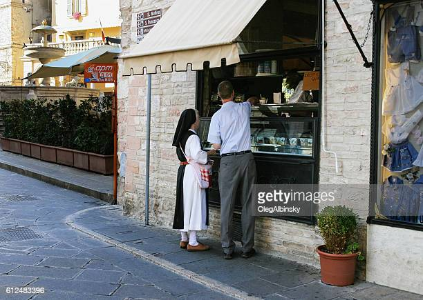 Nun Bying Ice Cream on a Street of Assisi, Italy.