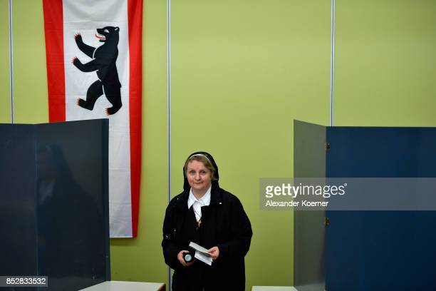 A nun casts her election ballots at a polling station during German federal elections on September 24 2017 in Berlin Germany German Chancellor and...