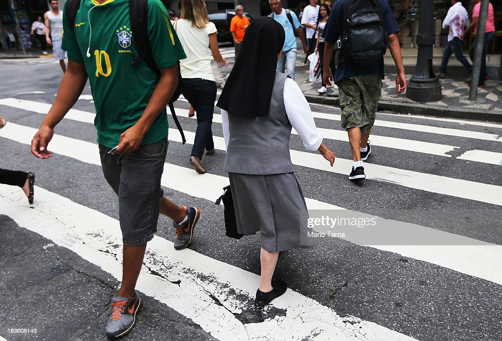A nun crosses a street outside the Se Cathedral, the cathedral of the Roman Catholic Archbishop of Sao Paulo, Cardinal Odilo Pedro Scherer, on March 13, 2013 in Sao Paulo, Brazil. Brazil has more Catholics than any other country in the world and supporters hope Sao Paulo Archbishop Cardinal Odilo Pedro Scherer will be chosen as the next Pope during the papal conclave.