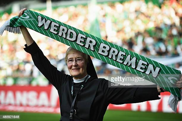 A nun fan of Bremen holds her scarf during the Bundesliga match between Werder Bremen and Borussia Moenchengladbach at Weserstadion on August 30 2015...