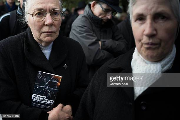 A nun holds a flyer as she takes part in a silent march to commemorate the 75th anniversary of the Kristallnacht pogroms on November 9 2013 in Berlin...