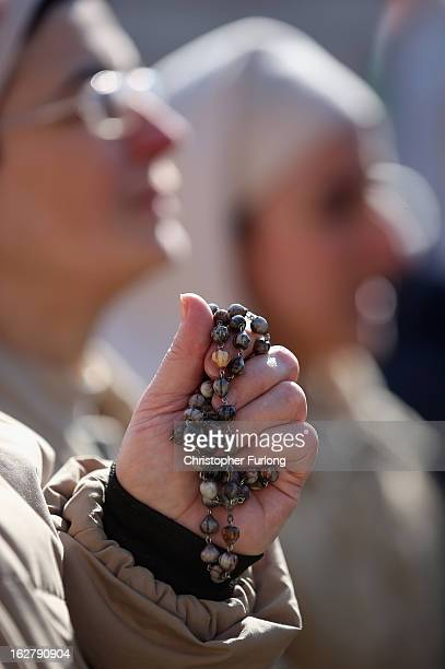 A nun holds her rosary beads as she attends Pope Benedict XVI's final general audience in St Peter's Square before his retirement on February 27 2013...