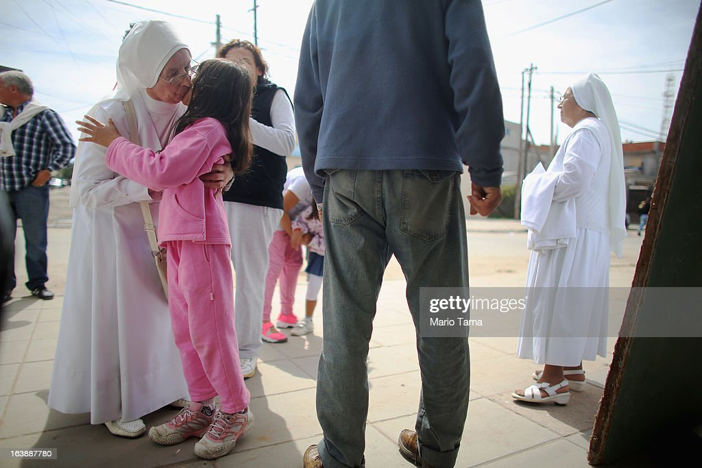 A nun kisses a girl outside the Virgin of the Miracles of Caacupe church following Sunday Mass in the Villa 21-24 slum, where archbishop Jorge Mario Bergoglio, now Pope Francis, used to perform charity work, on March 17, 2013 in Buenos Aires, Argentina. Francis was the archbishop of Buenos Aires and is the first Pope to hail from South America. Some locals are now affectionately calling Francis, known for his charity work in the slums, the 'slum pope.'