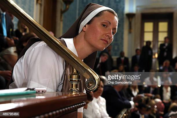 A nun listens as Pope Francis addresses a joint meeting of the US Congress in the House Chamber of the US Capitol on September 24 2015 in Washington...
