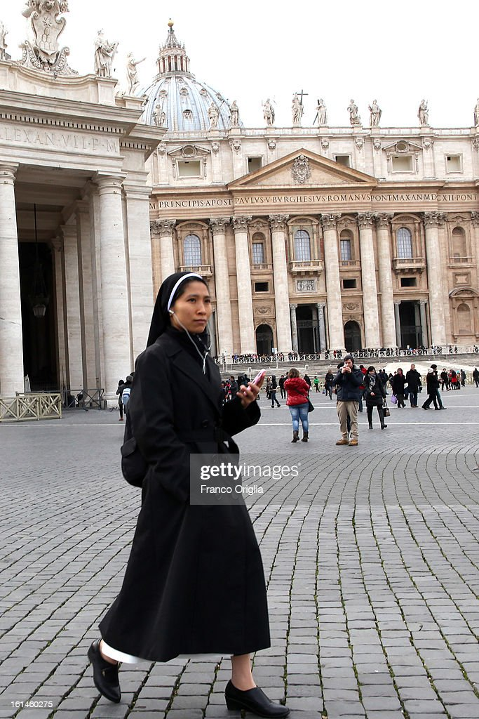 A nun listens on her smartphone as she walks in St. Peter's Square on February 11, 2013 in Vatican City, Vatican. Pope Benedict XVI today announced that he is to retire on February 28 citing age related health reasons.