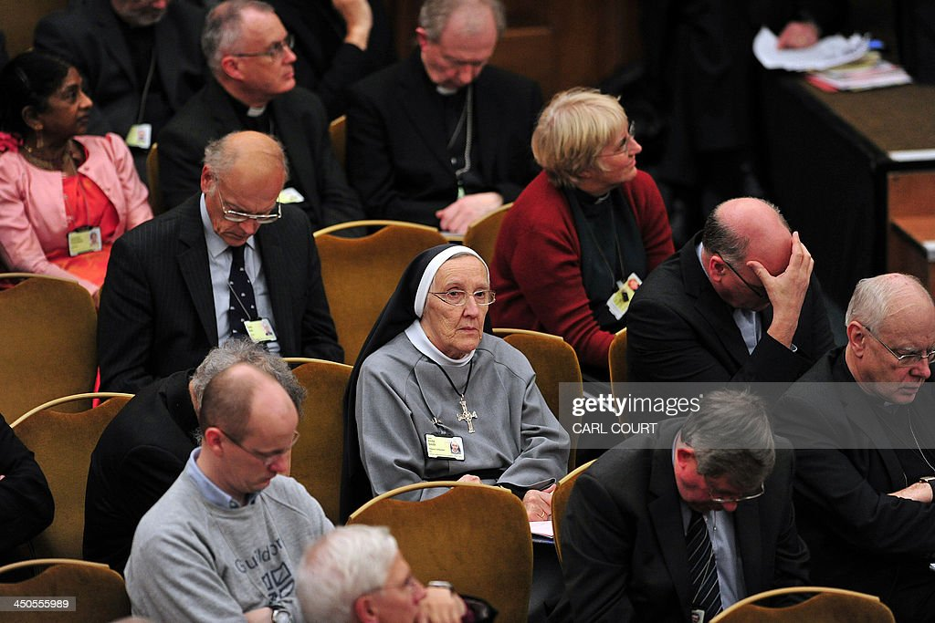 A nun listens to a speech by the Archbishop of York John Sentamu on the second day of the Church of England's General Synod in central London on...