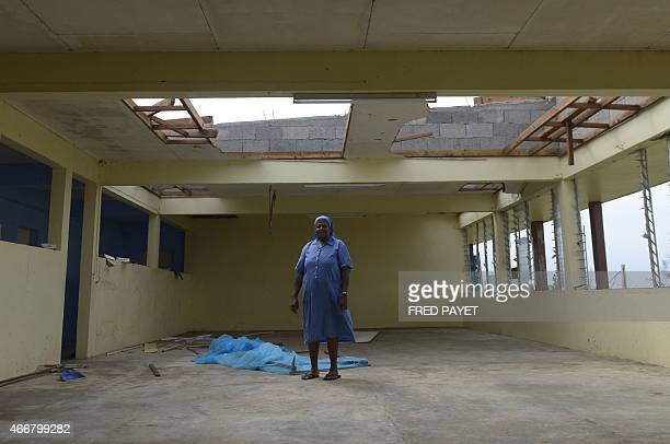 A nun looks at damages on March 19 2015 in the Catholic French speaking Lycee De Montmartre 5 km from Port Vila after Severe Tropical Cyclone Pam hit...