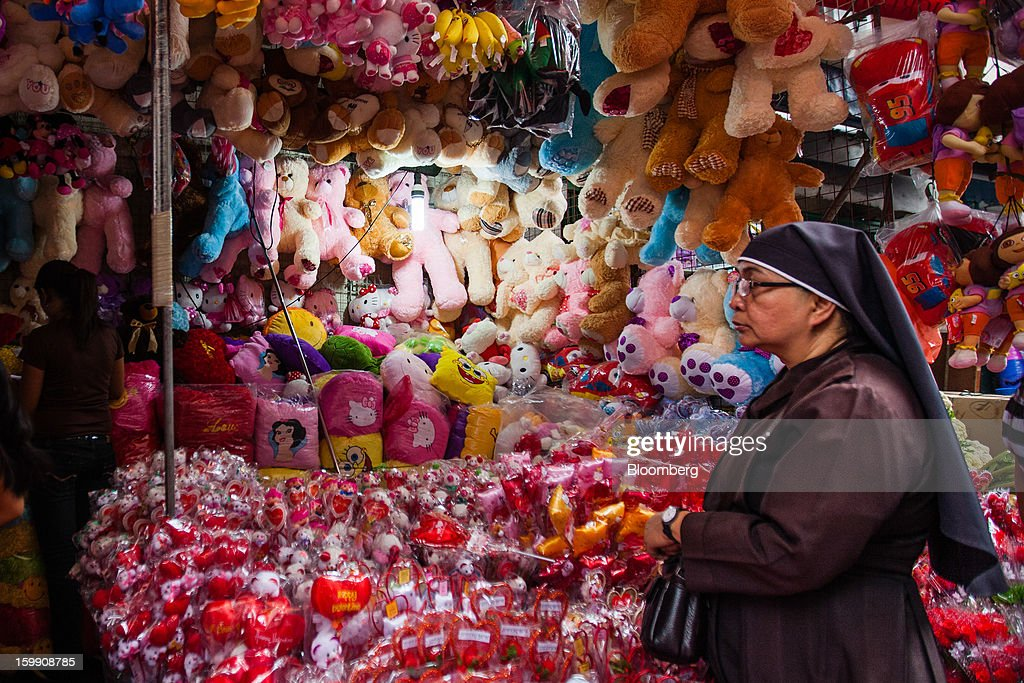 A nun looks at stuffed toys for sale at a stall at the Divisoria market in Manila, the Philippines, on Tuesday, Jan. 22, 2013. Philippine government bonds advanced on speculation the central bank will hold its benchmark interest rate at a record low at a meeting tomorrow, supporting demand for the nation's debt. Photographer: Julian Abram Wainwright/Bloomberg via Getty Images
