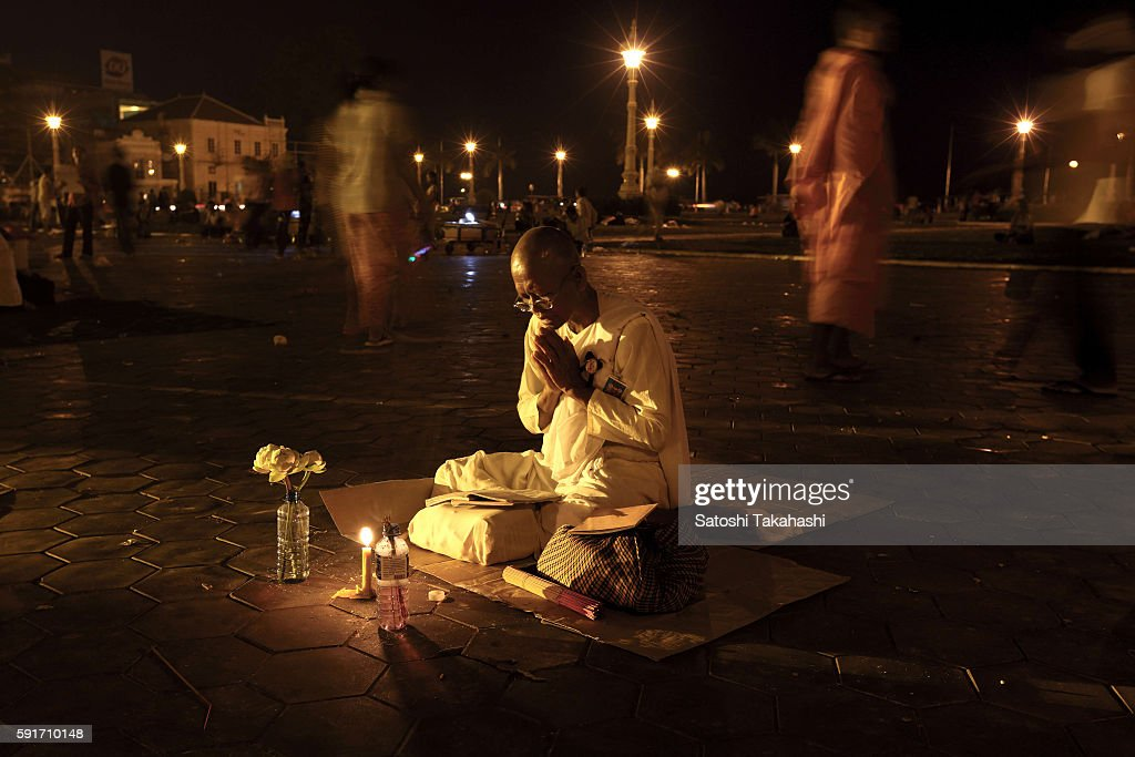 A nun pays their respects to King father Norodom Sihanouk in front of the royal palace several days before a state funeral begins The King died on...