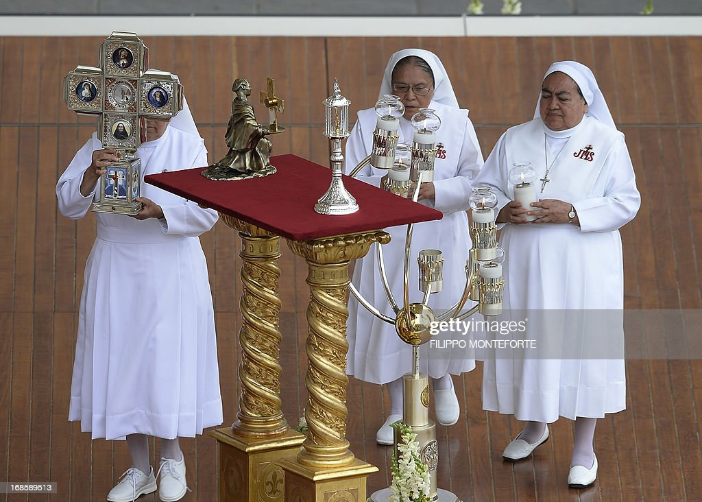 A nun (L) places the relic of Mexican Maria Guadalupe Garcia Zavala on an altar near those of Colombian Laura Montoya Upegui and Italian Antonio Primaldo in St. Peter's square at the Vatican during the Canonization mass on May 12, 2013. Pope Francis canonized the first saints of his reign, an Italian from the fifteenth century martyred for refusing to convert to Islam, as well as a Colombian and a Mexican who both died in the twentieth century.