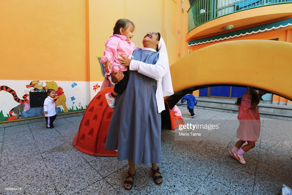 A nun plays with a child in the Instituto Nuestra Senora del Huerto Catholic school, founded in 1872, which Pope Francis visited, on March 18, 2013 in Buenos Aires, Argentina. Francis was the archbishop of Buenos Aires and is the first Pope to hail from South America. Francis will be officially installed as Pope tomorrow at Saint Peter's Square.