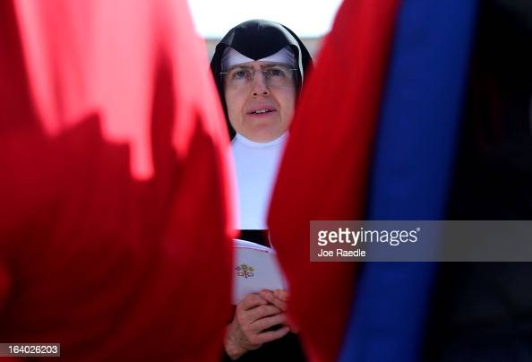 A nun prays during the Inauguration Mass for Pope Francis in St Peter's Square on March 19 2013 in Vatican City Vatican The mass is being held in...