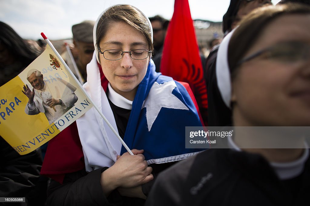 A nun prays holding a flagg pictured a photograph of Pope Benedict XVI on February 24, 2013 in Vatican City, Vatican. Pope Benedict XVI delivers his last Angelus Blessing from the window of his private apartment to thousands of pilgrims gathered in Saint Peter's Square on February 24, 2013 in Vatican City, Vatican. The Pontiff will hold his last weekly public audience on February 27, 2013 before he retires the following day. Pope Benedict XVI has been the leader of the Catholic Church for eight years and is the first Pope to retire since 1415. He cites ailing health as his reason for retirement and will spend the rest of his life in solitude away from public engagements.