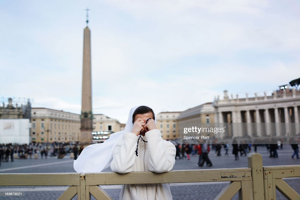 A nun prays in St. Peter's Square the afternoon after the election of Pope Cardinal Jorge Mario Bergoglio of Argentina, who will take the name Pope Francis on March 14, 2013 in Vatican City, Vatican. A day after thousands gathered in St. Peter's Square to watch the announcement of the first ever Latin American Pontiff it has been announced that Pope Francis's inauguration mass will be held on March 19, 2013 in Vatican City.