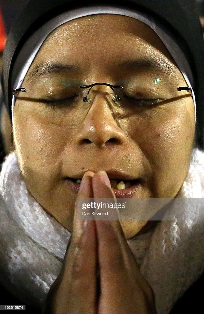 A nun reacts as newly elected Pope Francis I appears on the central balcony of St Peter's Basilica on March 13, 2013 in Vatican City, Vatican. Argentinian Cardinal Jorge Mario Bergoglio was elected as the 266th Pontiff and will lead the world's 1.2 billion Catholics.