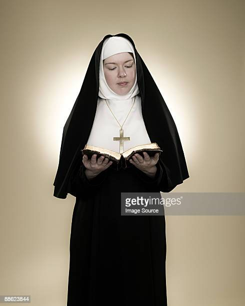 A nun reading a bible