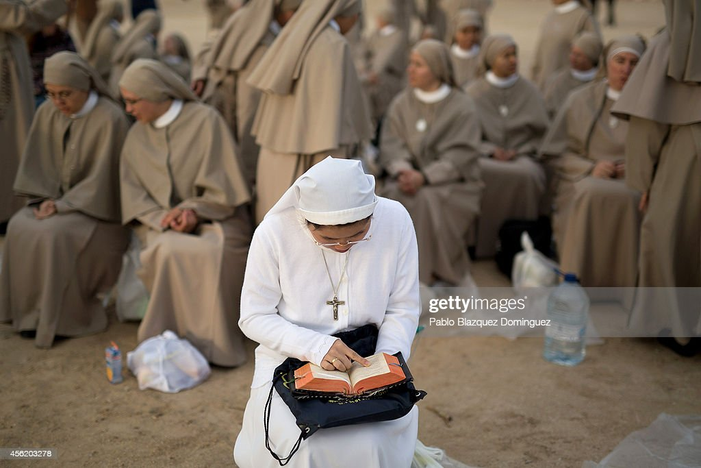 A nun reads as she waits for the start of the beatification ceremony for Opus Dei former leader Alvaro del Portillo on September 27 2014 in Madrid...