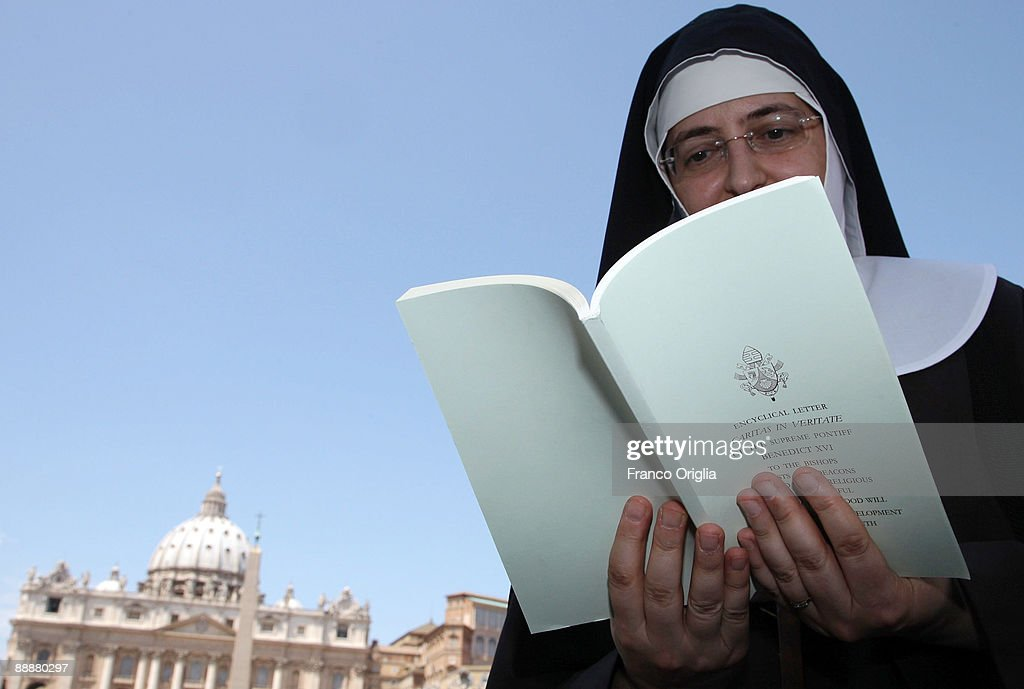 a nun reads the new encyclical letter caritas et veritate of pope benedict xi at st