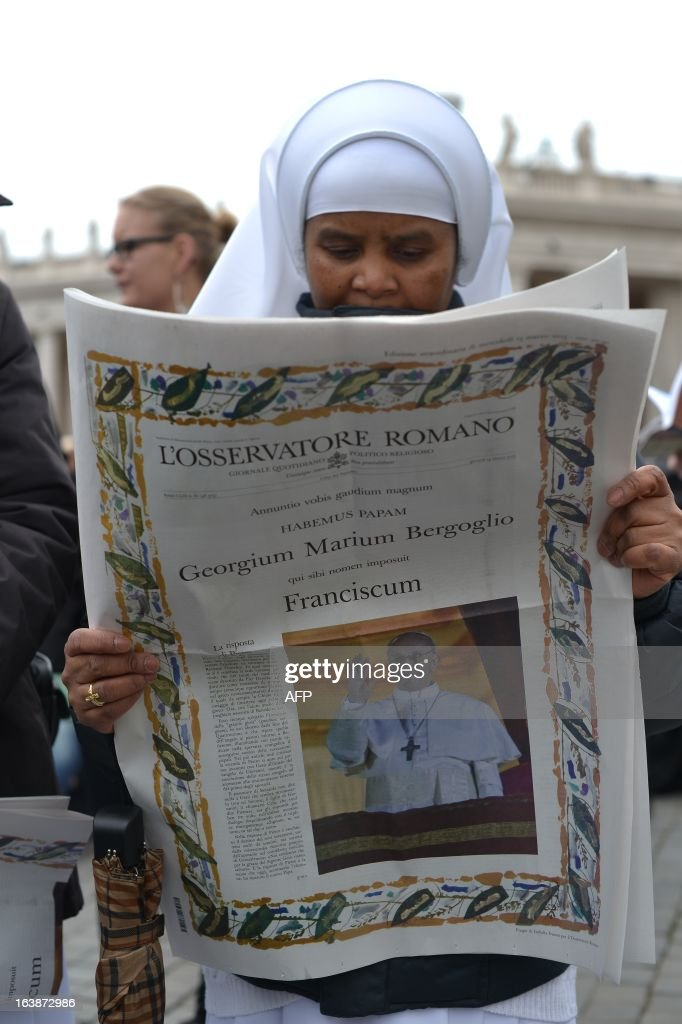 A nun reads the Osservatore Romano, Vatican's newspaper, before pope's first Angelus prayer at St Peter's square on March 17, 2013 at the Vatican. Pope Francis begins his papacy in earnest today ahead of his formal inauguration mass, with a weekly prayer address used by previous pontiffs to comment on international affairs. The pope's first Angelus prayer, delivered from a window high above St Peter's Square, is a chance for the first Latin American pontiff to begin to sketch out a more global vision for the role of the Roman Catholic Church. AFP PHOTO / GABRIEL BOUYS