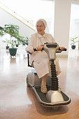 Disabled nun riding a motorized wheelchair