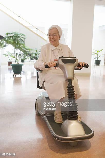 Nun riding a motorized wheelchair