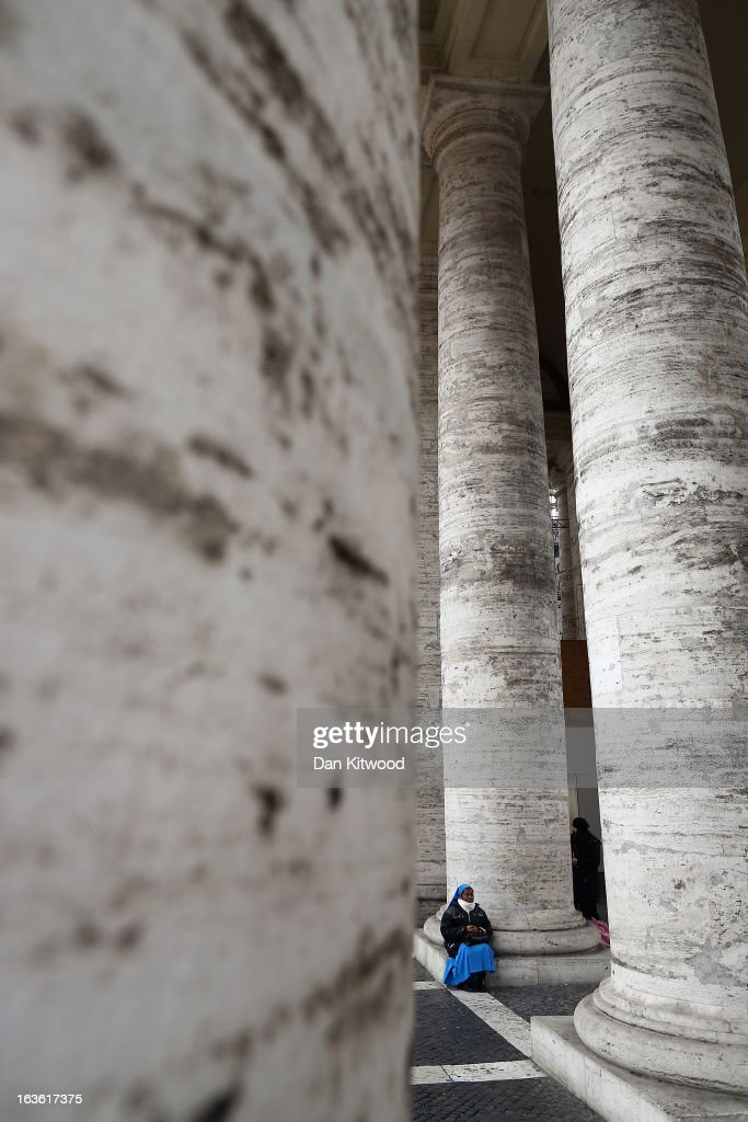 A nun sits under the colonnade in St Peter's Square on March 13, 2013 in Vatican City, Vatican. Argentinian Cardinal Jorge Mario Bergoglio was later elected as the 266th Pontiff and will lead the world's 1.2 billion Catholics.