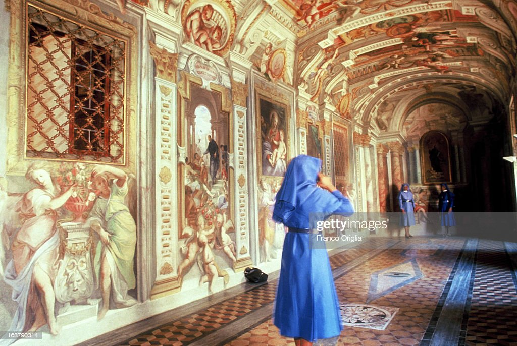 A nun takes a picture of fellow nuns posing in the corridor of the Italian painter and architect Andrea Pozzo taken in the rooms of Saint Ignatius of Loyola, founder of the Jesuits in 1991 in Rome, Italy. The Argentinian Cardinal Jorge Mario Bergoglio was ordained for the Jesuits on 1969 at the Theological faculty of San Miguel and was elected as Pope Francis on March 13, 2013 as the first ever Jesuit pontiff. The Society of Jesus, founded in 1540 by the Spanish Ignatius of Loyola's, is a Christian male religious order of the Roman Catholic Church. The society is engaged in evangelization and apostolic ministry in 112 nations and on six continents. Jesuits operate in education (founding schools, colleges, universities and seminaries), intellectual research and cultural pursuits.