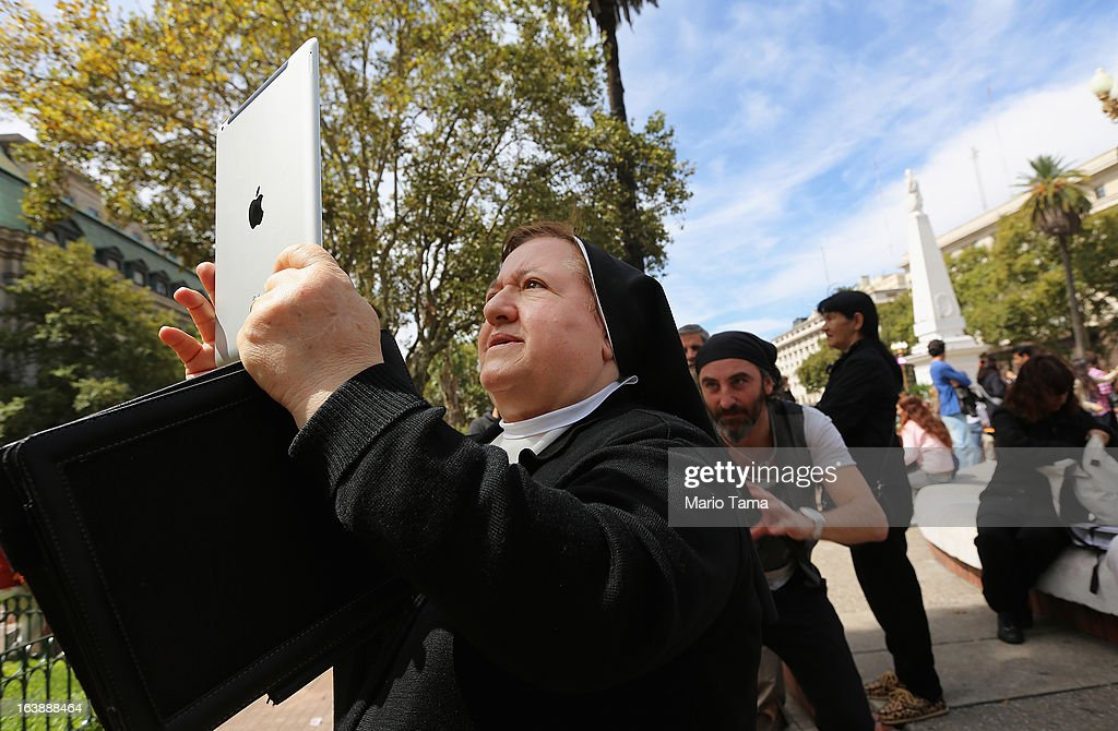 A nun takes in activity with an iPad following Sunday Mass honoring Pope Francis outside the Metropolitan Cathedral on March 17, 2013 in Buenos Aires, Argentina. Francis was the archbishop of Buenos Aires and is the first Pope to hail from South America.