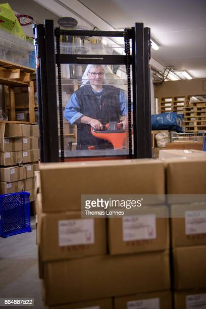 Nun Thekla of St Hildegard Abbey carrys boxes with wine bottels in the cellar on October 20 2017 near Rudesheim on the Rhine Germany The St Hildegard...