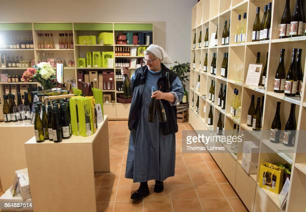 Nun Thekla of St Hildegard Abbey carrys vine bottels in the store 'Vinothek' on October 20 2017 near Rudesheim on the Rhine Germany The St Hildegard...