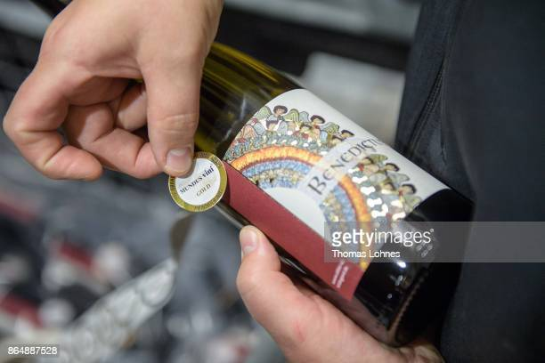 Nun Thekla of St Hildegard Abbey labes wine bottels with an award label in the cellar on October 20 2017 near Rudesheim on the Rhine Germany The St...