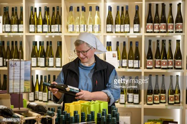 Nun Thekla of St Hildegard Abbey looks to a vine bottle in the store 'Vinothek' on October 20 2017 near Rudesheim on the Rhine Germany The St...