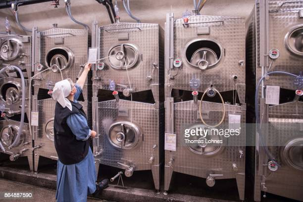 Nun Thekla of St Hildegard Abbey looks to the stainless steel tanks with the Riesling wine in the cellar on October 20 2017 near Rudesheim on the...